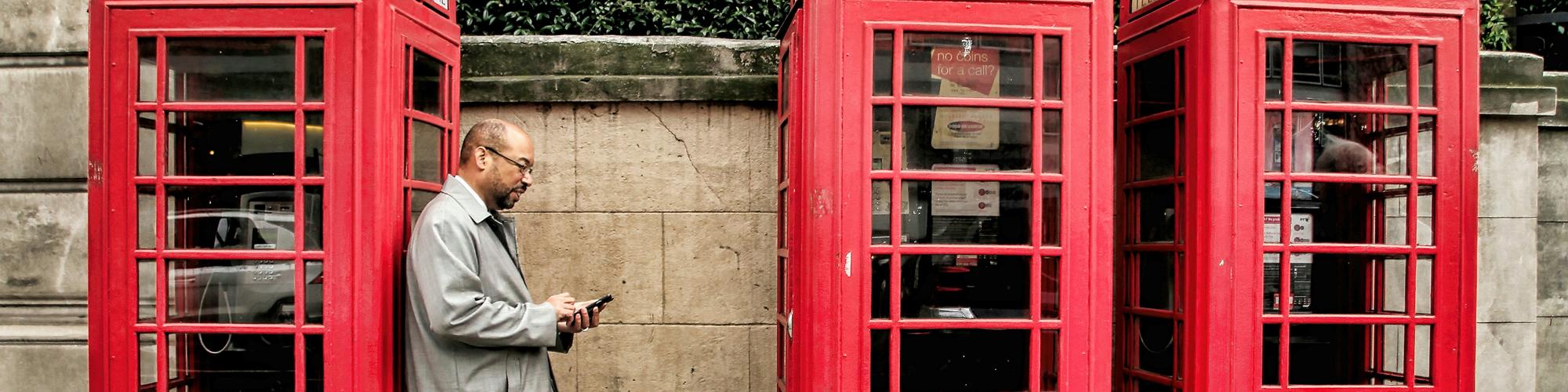 Cornelius Alexander beside phone boxes