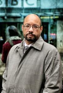 Cornelius in trench coat in front of BBC